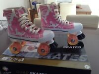 Girls roller skates in pink/white size 4