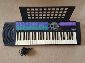 Yamaha PSR-73 Portatone Electronic Keyboard with Music Stand & Power Adaptor