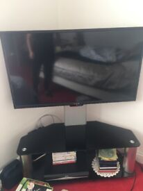 """40"""" godmans tv and stand"""