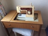 Singer Sewing machine and work table.
