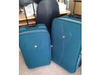 TWO MATCHING SUITCASES. TEAL, IN VERY GOOD CONDITION.