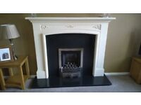 living flame gas fire with coals and cream fire surround in good working order