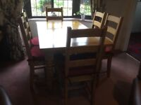 Beautiful Solid Oak Dining Table with 6 Ladder back chairs