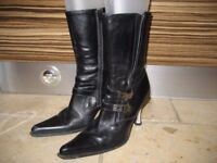 """New Rock"" ladies size 6 biker-style black leather boots with contrasting metal heels!"