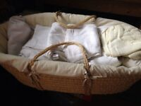 Lovely quality Moses basket with bedding on solid wooden rocking stand