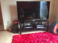 Black glass tv stand to fit 55 inch tv, matching glass corner unit and three shelf table. Vgc