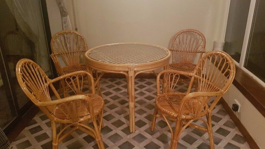 Cane furniture set - Dining table (4 chairs), Shelving unit and table.