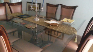Dinning Table with 8 Leather chairs with wooden carving