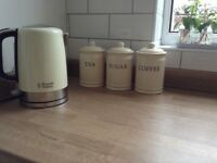 Russell Hobbs kettle and matching tea, sugar and coffee canisters.