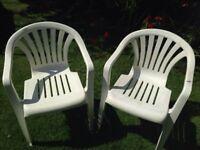 2x White plastic garden chairs