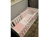Mother care crib with 'my little garden' bedding