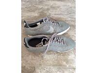 Grey Nike Cortez trainers
