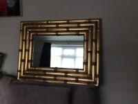 Lovely bamboo type gold framed mirror