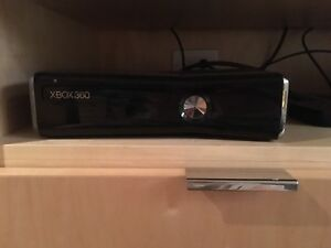"Xbox 360 ""slim"" 250GB (includes 2 controllers and 29 games)"