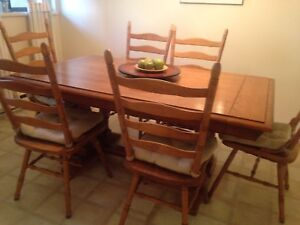 "Solid oak, 66 1/2""x39 3/4"" with 2 -12"" leafs & 6 custom chairs"