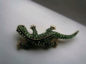 Lovely Tsavorite Garnet brooch with diamonds.