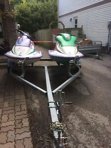 Two sea doos for sale with double trailer