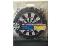 New dartboard with darts