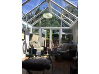 A quality double glazed glass conservatory with feature glazing and multipoint security locks.