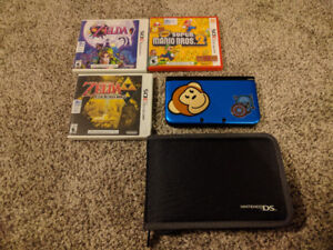 Nintendo 3DS XL + 5 games and more!