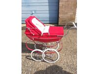 Selling a Red Silver Cross coach built dolls pram excellent for collectors