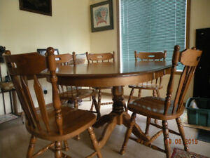 solid wood dining table and 5 matching chairs