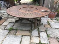 6ft round garden table and 8 chairs with cushions and parasol