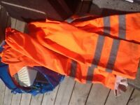 8 pairs of hi viz trousers size large.