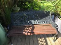 decorative cast iron and wooden garden bench,