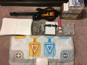 Wii console,  accessories, and 20+ games