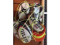 5 rugby balls with cones