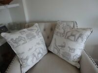 Two lovely animal design cushions.