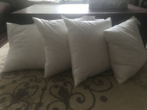 Four feather throw pillows (cases not included!)