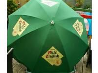 Large unused pub garden umbrellas