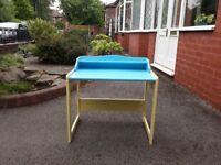 Desk for young children, blue and light yellow. Erected and in good condition.
