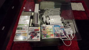Nintendo Wii with 6 games,4 remotes,2 nunchuck and balance board