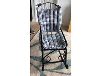 Child's cast iron rocking chair with padded cushions