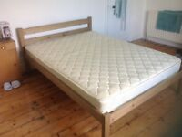 Timber framed double bed with mattress