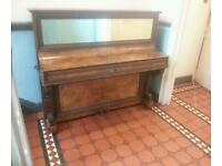 Ornate German overstrung piano CAMDENPIANORESCUE can deliver