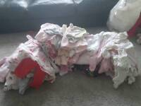 Bundle of newborn baby girls clothes