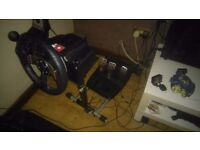 Logitech G27 steering wheel with pedals, gear shifter and stand