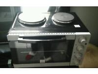 Electric oven with hobs
