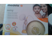 medela swing electric pump in excellent condition with newly sterile accessories