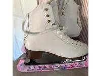 Almost new ice skates, blade guard and carry bag.
