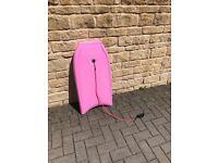 pink bodyboard