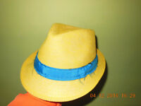 Yellow hat with blue band.