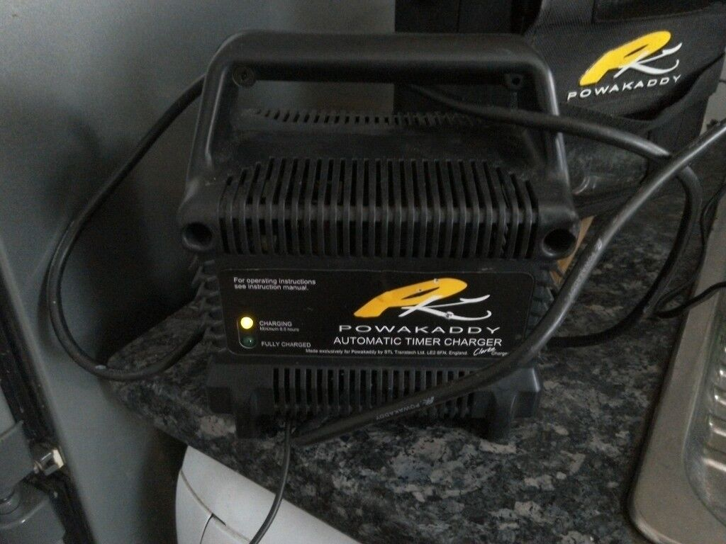 PowaKaddy battery and charger for electric golf trolley both working.