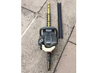 RYOBI Hedge trimmer starts and runs can be seen working..