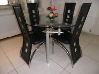 Glass table & Designer Chairs