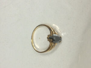 10k gold ring with black stone and 2 diamonds